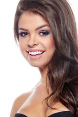 sensual brunette woman with shiny  silky hair studio shot