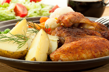 Roasted chicken wings with young potatoes