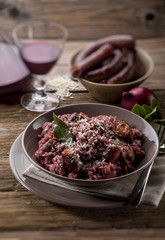 risotto with red wine and sausage, selective focus