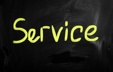 """service"" handwritten with white chalk on a blackboard"