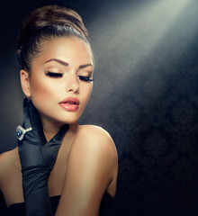 Wall Mural - Beauty Fashion Girl Portrait. Vintage Style Girl Wearing Gloves