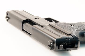 Black hand gun against white background