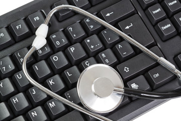 Computer Keyboard for PC and stethoscope as a diagnostic. Close-