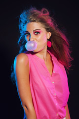 Sexy vintage 80s fashion bubble gum girl with long blonde hair.
