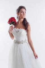 Portrait of concentrated bride posing in studio