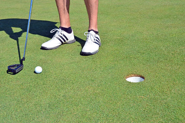 Golf ball golf shoes and stick