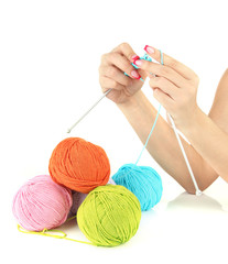 Hands of young woman knitting with blue wool, isolated on white