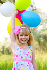 Portrait of little girl with balloons