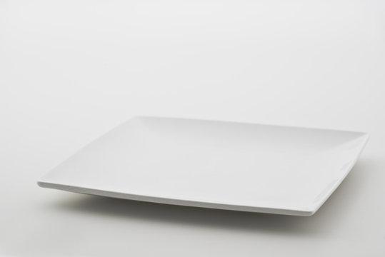 Porcelain plates on white background