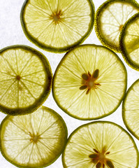 Some lime slices on white