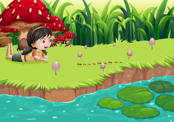 A girl at the riverbank near the red mushrooms
