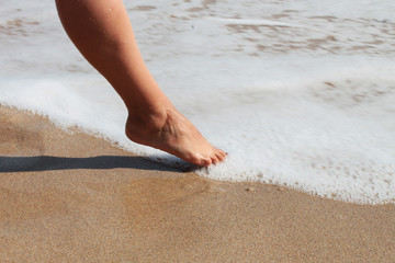 Closeup picture of woman's leg in the sea