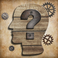 Human head silhouette with question mark concept