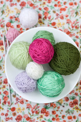 A lot of bright balls of knitting on the background