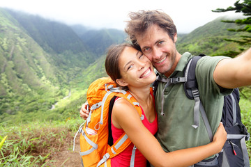 Hiking couple - young couple in love on Hawaii