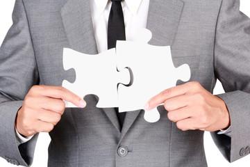 Businessman holding mismatch jigsaw