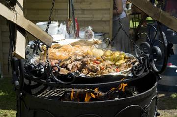 Shish kebab, potato.  Preparation on a brazier and a fire.