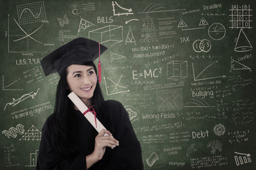 Beautiful woman graduated in class wearing graduation gown