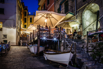 Fototapete - Illuminated Street of Riomaggiore in Cinque Terre at Night, Ital