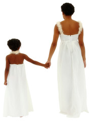 Back side of mother daughter holding hands wearing white angel d