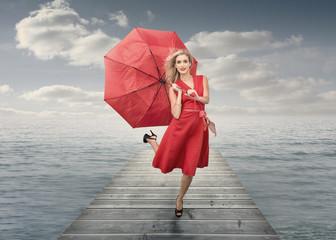 Beautiful woman holding umbrella