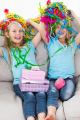Twins playing with confetti during their birthday