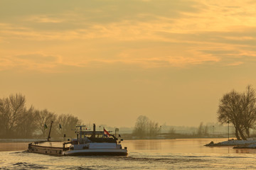 Riverboat during winter on the river IJssel in The Netherlands