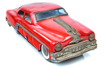 Fifties vintage red car toy isolated on white