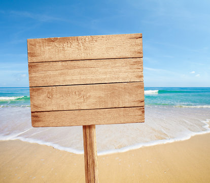 wood road sign on sea beach
