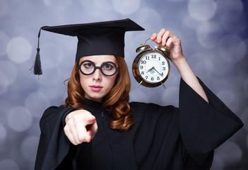 Redhead student with big clock