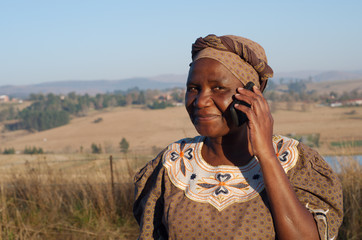 Traditional African Zulu woman speaking on mobile phone
