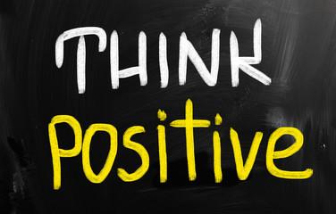 """Think positive"" handwritten with chalk on a blackboard"