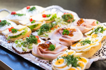 Sandwiches with cold cuts at a buffet