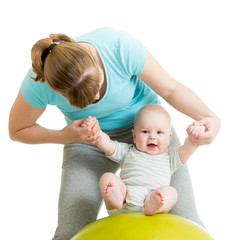 mother playing with baby on gymnastic ball