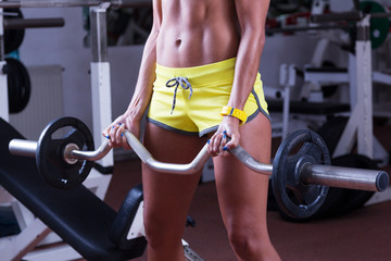 Girl lifting weights at gym