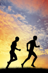 men running at sunset
