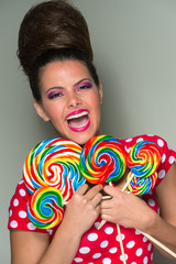 Playful vivacious woman with lollipops