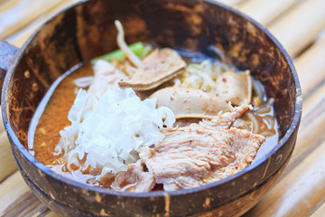 Thai spicy noodle in coconut shell