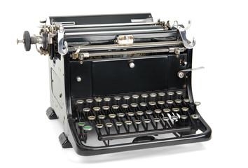 Old typewriter isolated on white.