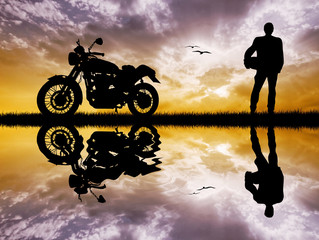 Wall Mural - motorcyclist at sunset