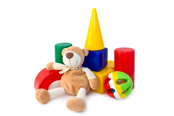 Box of bricks with a teddy bear and rattle