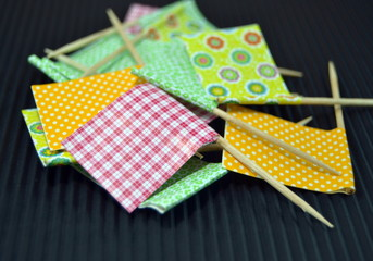 Colored flags to decorate snacks, close up