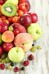 Assortment of juicy fruits, on wooden background