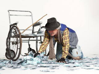 homeless man with a lot of money
