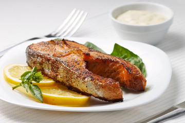 Grilled Salmon Steak with Lemon and Basil on Plate