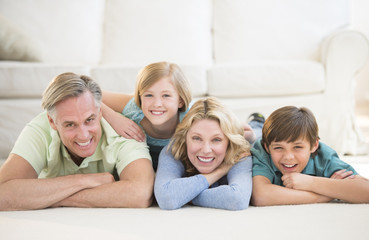 Family Lying On Floor At Home