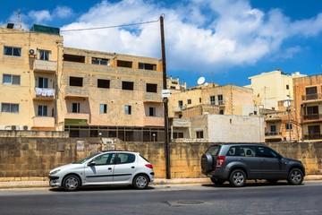 Old street full of ruined houses in Malta