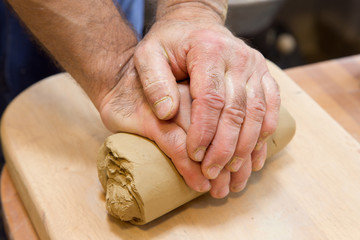hands of potter at work