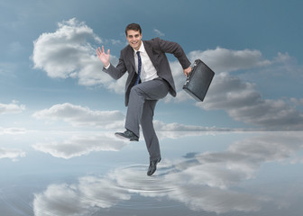 Businessman walking on a puddle