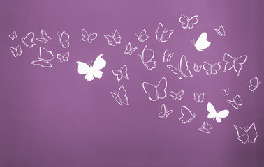 Background of white silhouettes butterflies flying